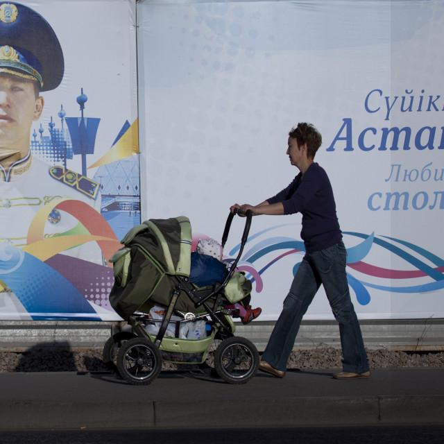 """""""Mother Pushing A Pram, Astana, Kazakhstan"""" stock image"""