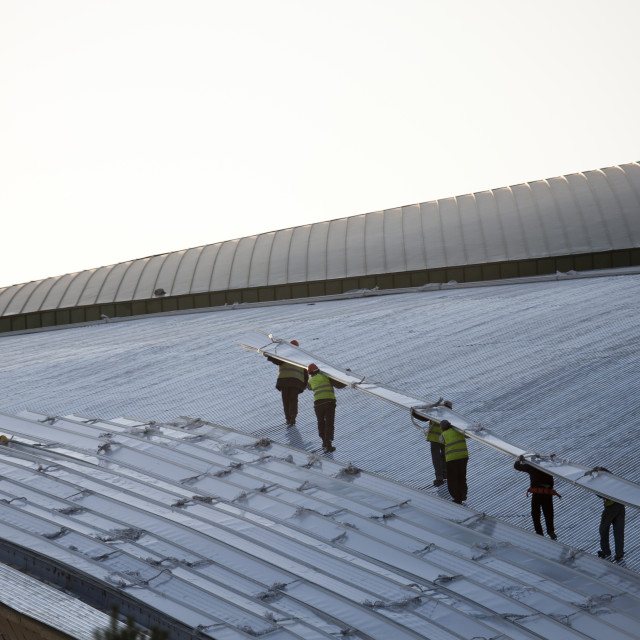 """Workers On The Roof Of The New Astana Stadium, Astana, Kazakhstan"" stock image"