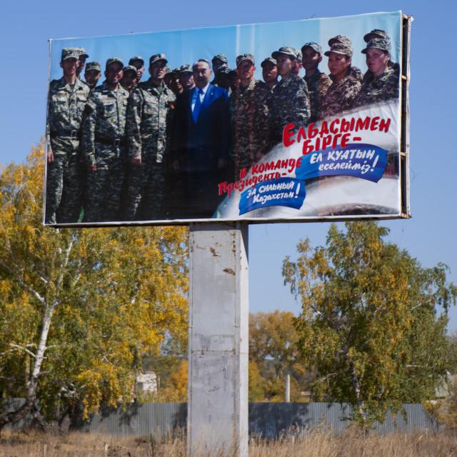 """Noursoultan Nazarbayev With The Army On A Propaganda Billboard, Kazakhstan"" stock image"