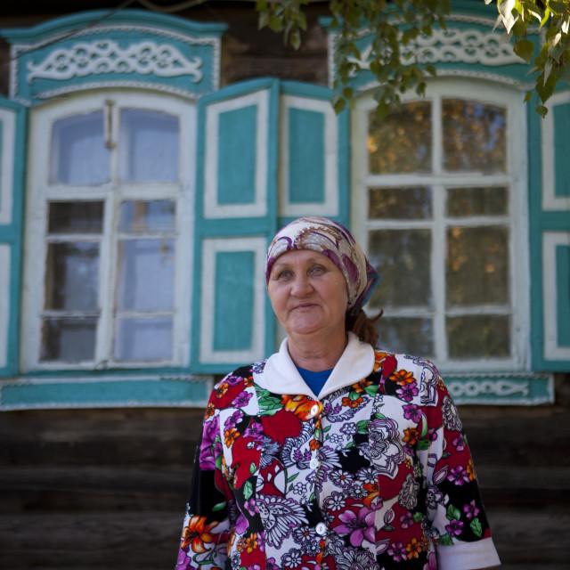 """Miss Zulfia, Tatar Nationality, In Front Of Her 1917 House, Burabay, Kazakhstan"" stock image"