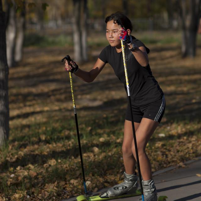 """""""Girl Roller Skiing In Astana Park, Kazakhstan"""" stock image"""