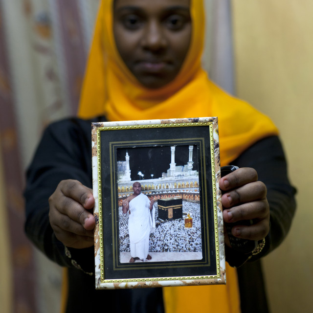 """""""Teenage Girl, Showing Picture Of Father's Haj To Mecca In Her House, Lamu, Kenya"""" stock image"""