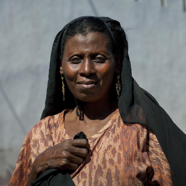 """Mid Adult Woman Portrait With Black Veil, Lamu Kenya"" stock image"