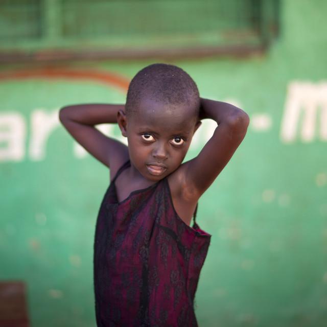"""Little Slum Boy Looking At Camera In Provocative Posture, Lamu Kenya"" stock image"