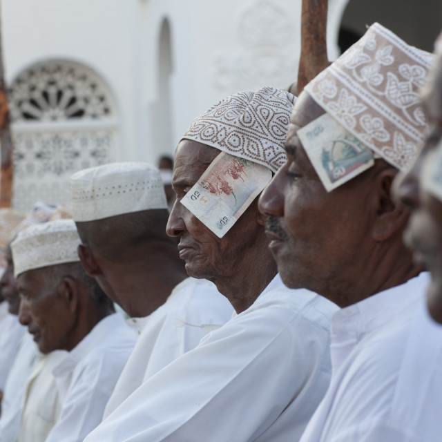 """Men In A Row With Banknotes In Kofia Hat, Maulidi Festival, Lamu Kenya"" stock image"
