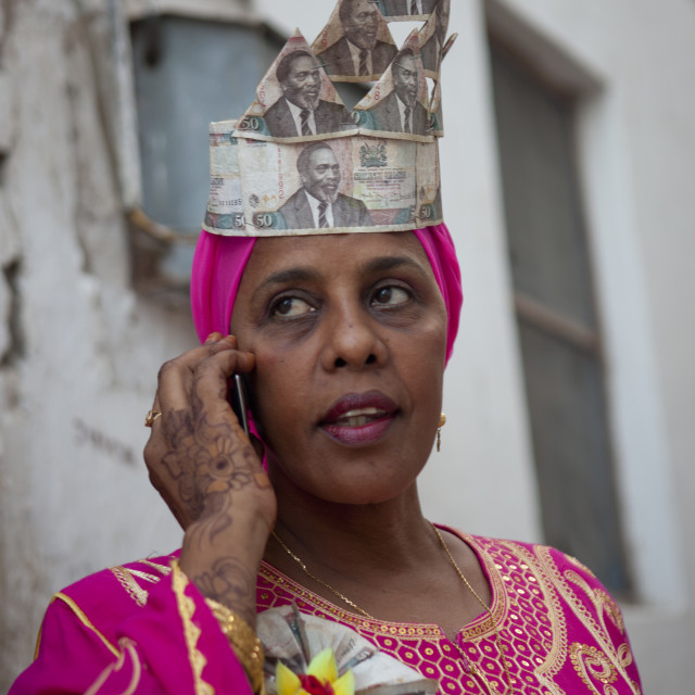 """Woman Calling With Cellphone, Wearing Banknotes Hat In Maulidi Festival,..."" stock image"
