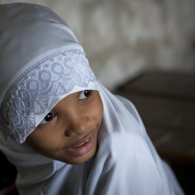 """Young Girl Wearing White Hijab Veil In The Classroom Of Stonetown Academy..."" stock image"