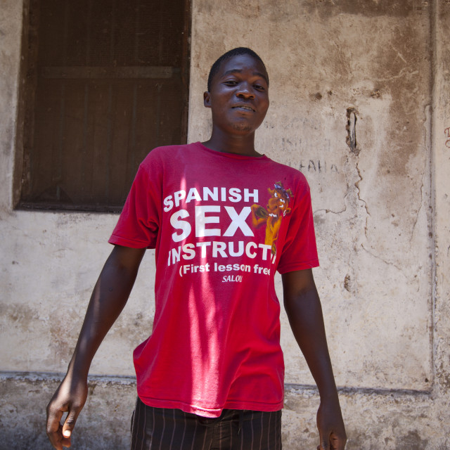 """Young man With A Sex Instructor Shirt In A Street Of Lamu, Kenya"" stock image"