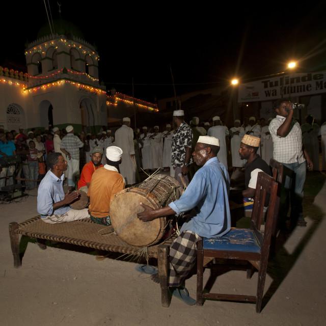 """""""Man Playing Drums At Night On Main Square, Crowd In Background, Lamu, Kenya"""" stock image"""