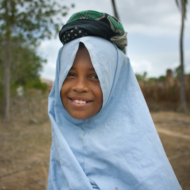 """Teenage Girl Wearing Hijab And Holding Cushion On Pate Island, Lamu, Kenya"" stock image"