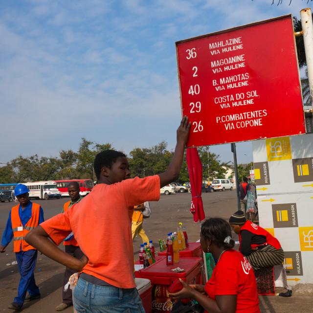 """Men At A Bus Stop, Maputo, Mozambique"" stock image"