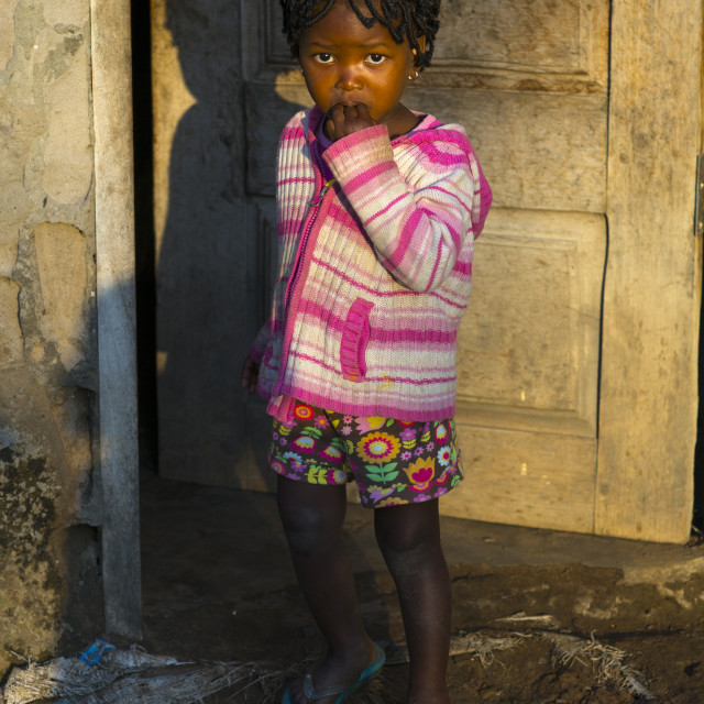 """Little Girl In The Sun, Maputo, Mozambique"" stock image"