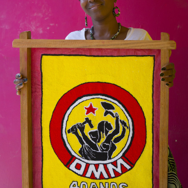 """Woman Holding A Propaganda Painting, Inhambane, Mozambique"" stock image"