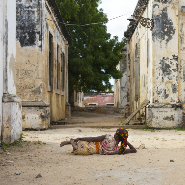 """""""Woman Lying On The Ground Inside The Old Hospital, Island Of Mozambique,..."""" stock image"""
