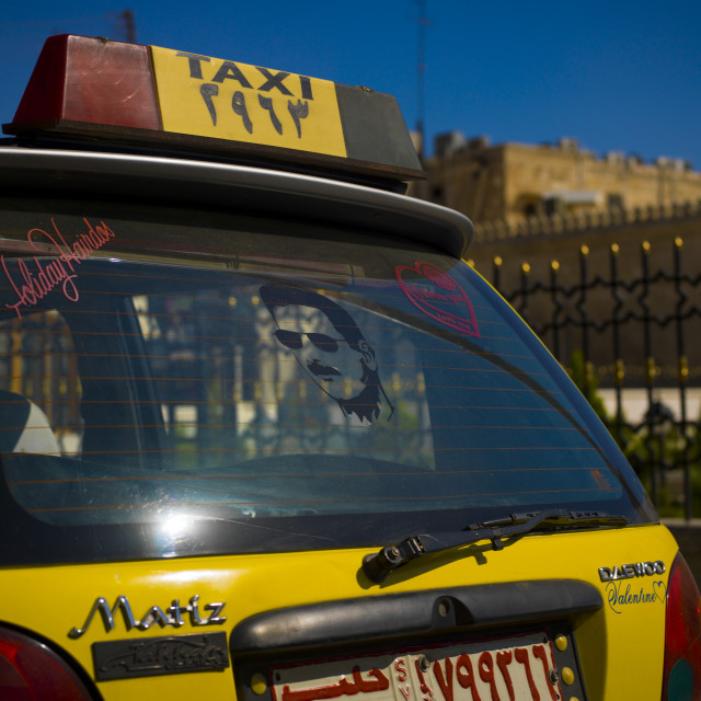 """""""Taxi With Bashar Al Assad Image On The Glass, Aleppo, Syria"""" stock image"""