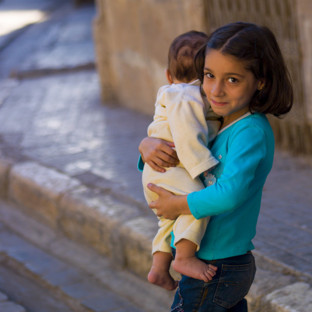 """""""Young Girl With Her Brother, Aleppo, Syria"""" stock image"""