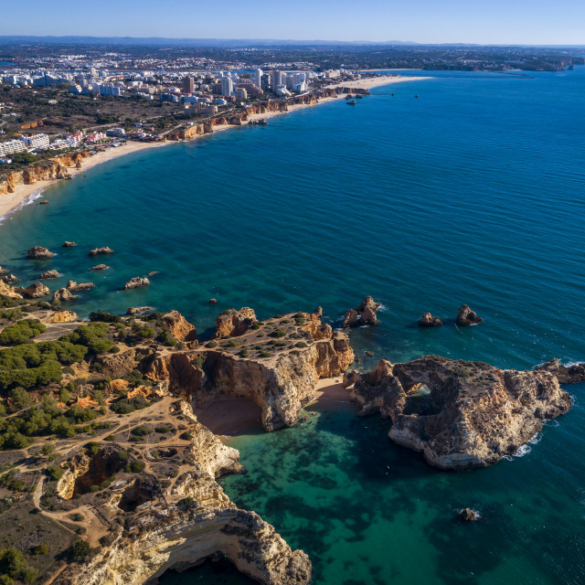 """Aerial view of the coastline with beautiful beaches along the city of Portimao in Algarve, Portugal"" stock image"