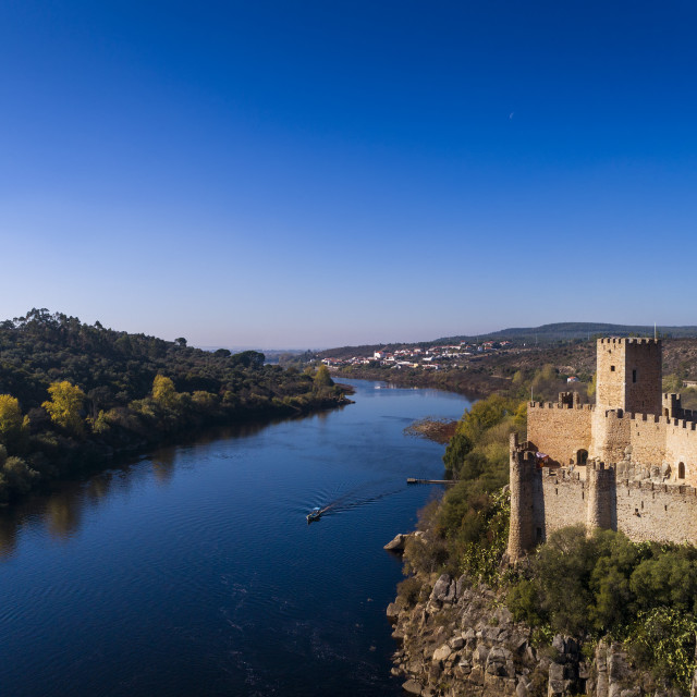 """""""Aerial view of the Armourol Castle with a boat passing in the Tagus River in Portugal; Concept for travel in Portugal"""" stock image"""