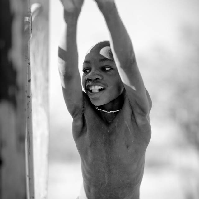 """Mucawana Doing The Chore Of Fetching Water, Village Of Oncocua, Angola"" stock image"