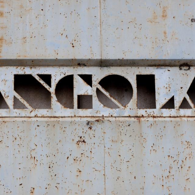 """Rusty Sign Of The Former Trade Bank In Vila Nova, Angola"" stock image"