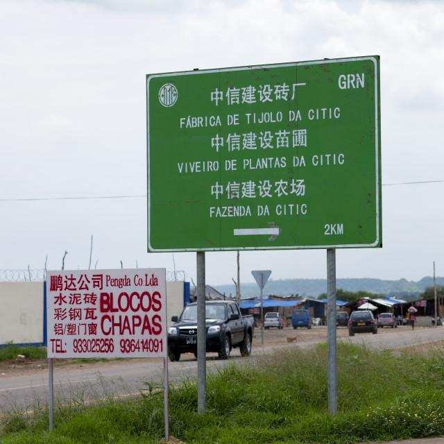 """Road Sign Indicating Chinese Companies, Luanda, Angola"" stock image"