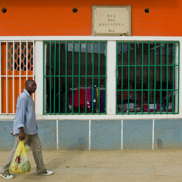 """""""Man Walking In The So Called Massacre Street In Sumbe, Angola"""" stock image"""