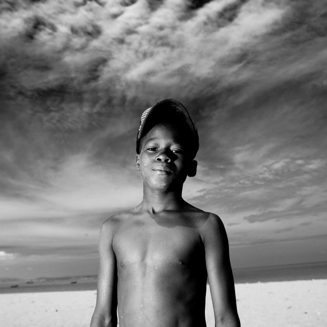 """Boy With Cap Covered With Sand, Benguela, Angola"" stock image"