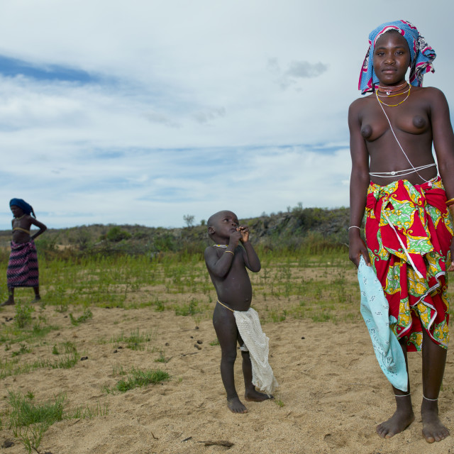 """Mucubal Boy Looking At His Mother, Virie Area, Angola"" stock image"