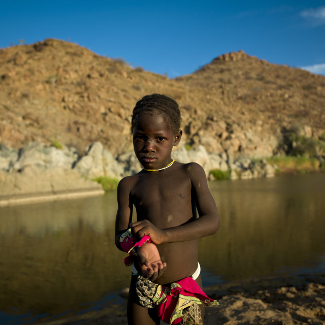 """""""Young Boy Covedred With Sand At Pediva Hot Springs, Angola"""" stock image"""