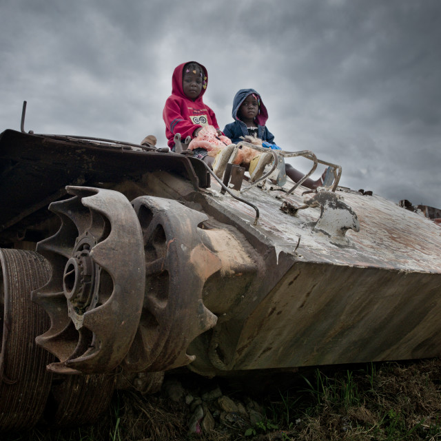 """Kids On A Tank Wreck From Civil War, Angola"" stock image"