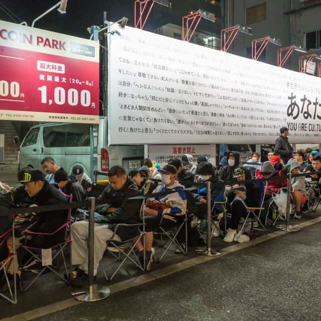 """""""People queueing and sleeping in the street for the opening of a new shop,..."""" stock image"""
