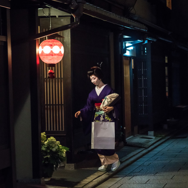 """""""Geisha in the streets of gion going inside a house, Kansai region, Kyoto, Japan"""" stock image"""