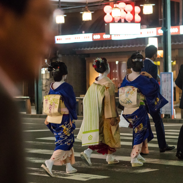 """Geishas with businessmen in the streets of gion, Kansai region, Kyoto, Japan"" stock image"