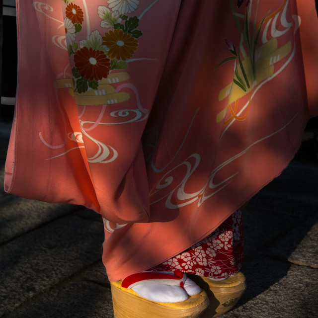 """A maiko called chikasaya walking with her traditional maiko clogs, Kansai..."" stock image"