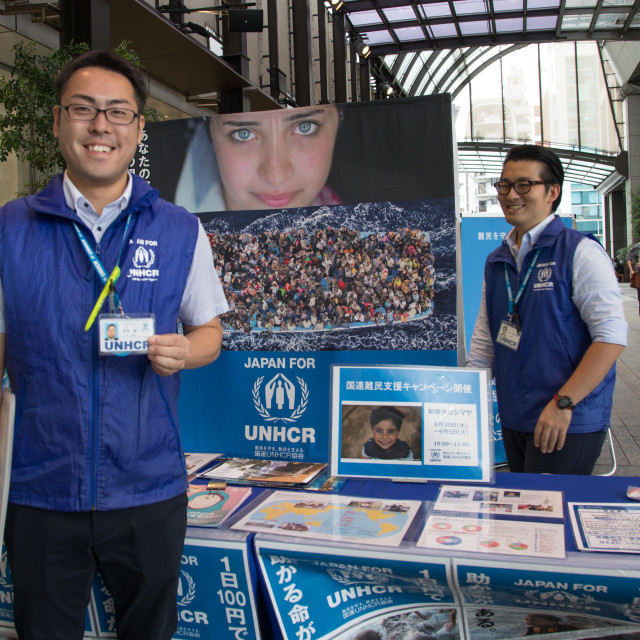 """Unhcr charity volunteers on street collecting money for refugees, Kanto..."" stock image"
