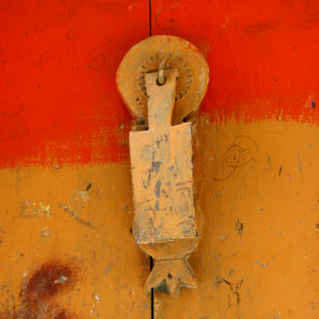 """""""Door Knocker On A Red And Orange Wooden Door, Sanaa, Yemen"""" stock image"""