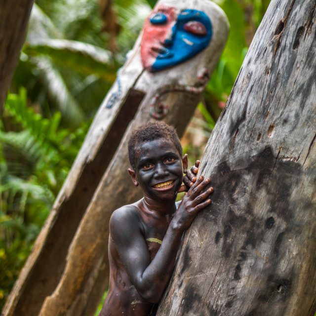 """""""Small Nambas tribe boy in front of a giant slit gong drum during a ceremony,..."""" stock image"""