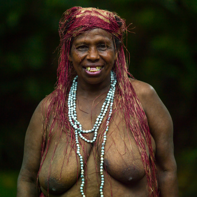 """""""Portrait of a Big Nambas tribe woman with upper teeth removed as a tradition,..."""" stock image"""