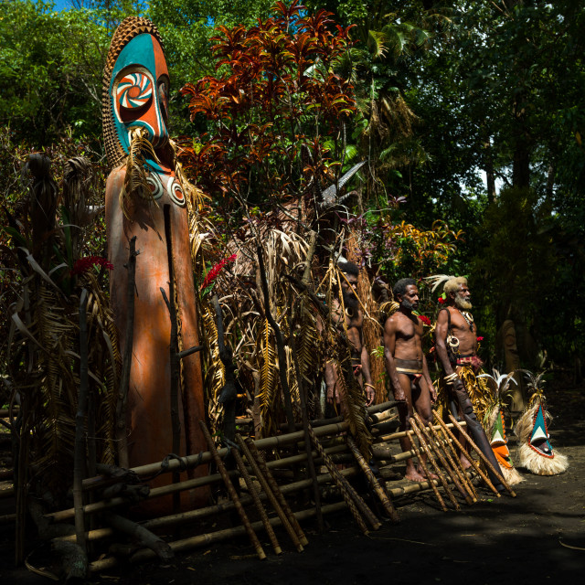 """""""Portrait of chieftain Etul on the Rom dance area in front of a giant slit..."""" stock image"""
