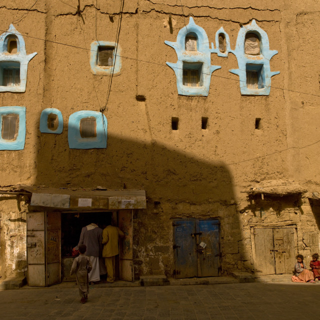 """Shops In An Adobe Building With Blue Painted Windows, Amran, Yemen"" stock image"