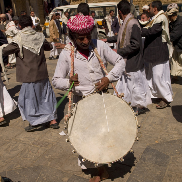 """Man Playing Drum At A Wedding In Thula, Yemen"" stock image"