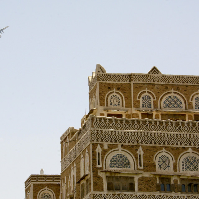 """Plane Passing Over A House In Sanaa, Yemen"" stock image"