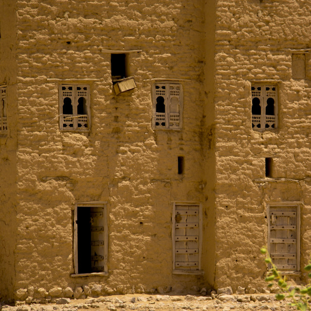 """""""Facade Of A Traditional Mud Building With Wooden Carved Windows, Hadramaut,..."""" stock image"""