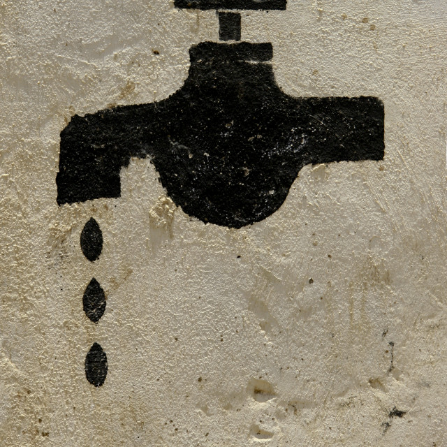 """Leaking Tap Painted On A Wall, Mocha, Yemen"" stock image"