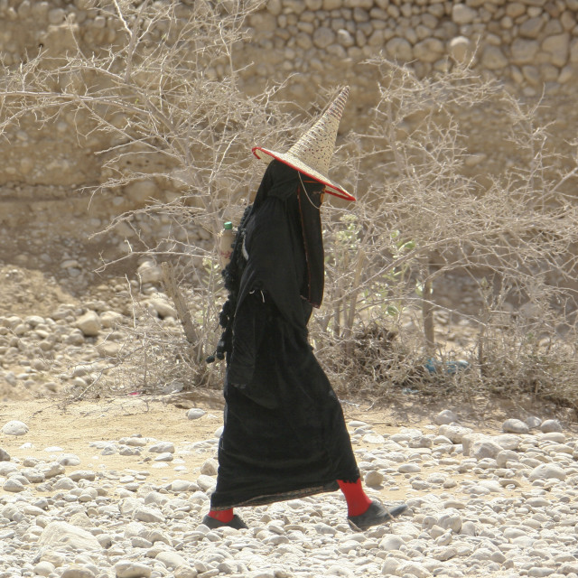 """""""Hadramaut Woman Dressed In Black And Wearing A Cone Hat Passing By,..."""" stock image"""