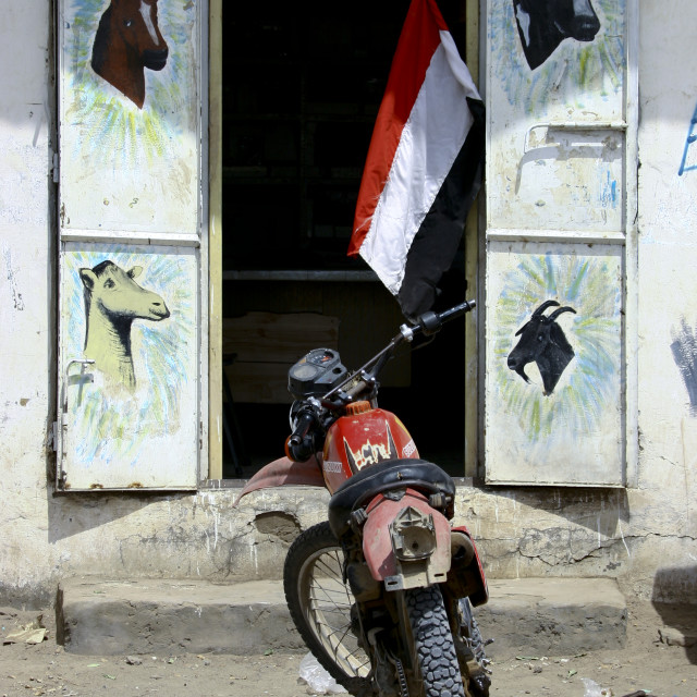 """Motocross Parked In Front Of A Shop With Animals Painted On The Doors And A..."" stock image"