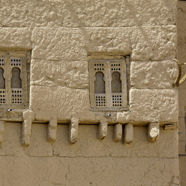 """""""Wooden Windows On A Adobe And Painted Building Wadi Doan, Yemen"""" stock image"""