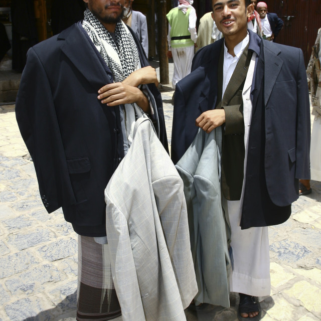 """Clothes Sellers Carrying Their Stock Around Sanaa, Yemen"" stock image"