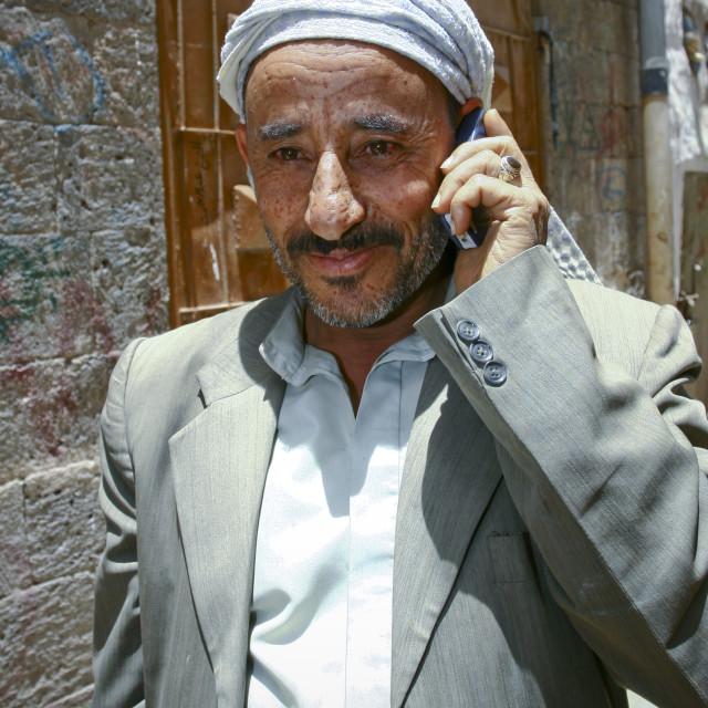 """Smiling Man On The Phone, Sanaa, Yemen"" stock image"