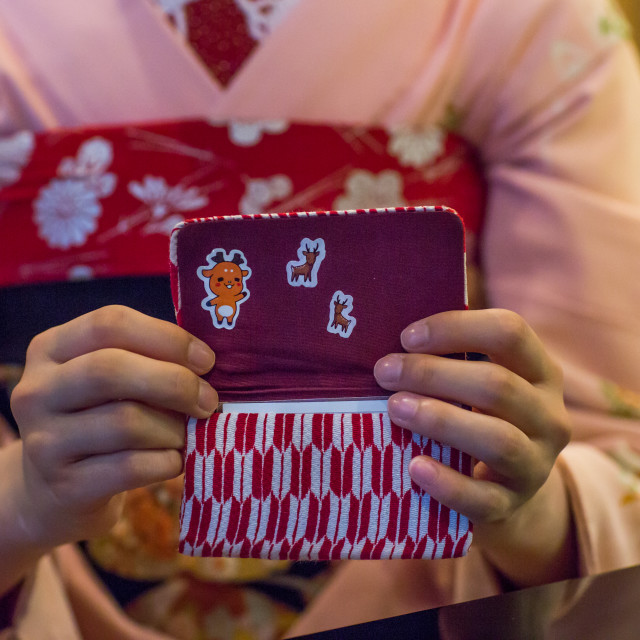 """16 Years old maiko called chikasaya showing cartoon stickers in her purse,..."" stock image"